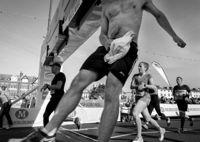 Shirtless and flying over the finish line